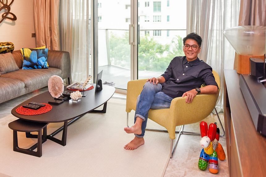 Mr Kelvin Neo in the living room of his 1,400 sq ft three-bedroom unit at the Corals at Keppel Bay condominium, which he bought in October 2017. For Mr Neo, the most important factor when selecting the property was accessibility, such as close proxim