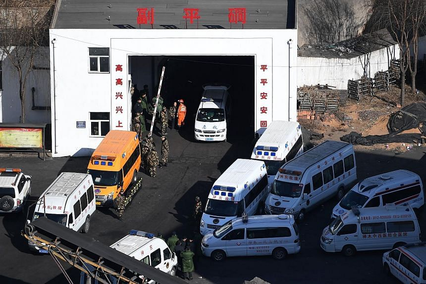 Rescuers at the coal mine owned by Baiji Mining in Shaanxi, China, yesterday. A total of 87 people were working underground when the roof of the mine collapsed on Saturday and 66 were safely evacuated. Rescuers found two remaining miners dead yesterd