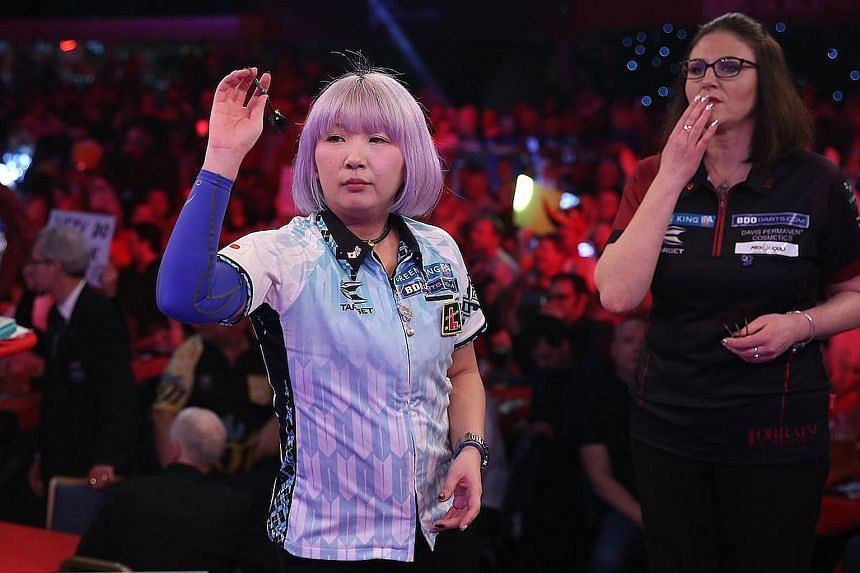 Mikuru Suzuki on her way to beating England's Lorraine Winstanley at the BDO World Championships. The Japanese is the first Asian player to win a world darts championship title.