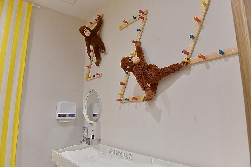 Above: Soft toys in the dressing room, which also has a nursing room, on level seven of the NUHkids Specialist Centre. Right: The reception area of level seven, which has a savannah theme. It is among three themed floors where consulting rooms are lo