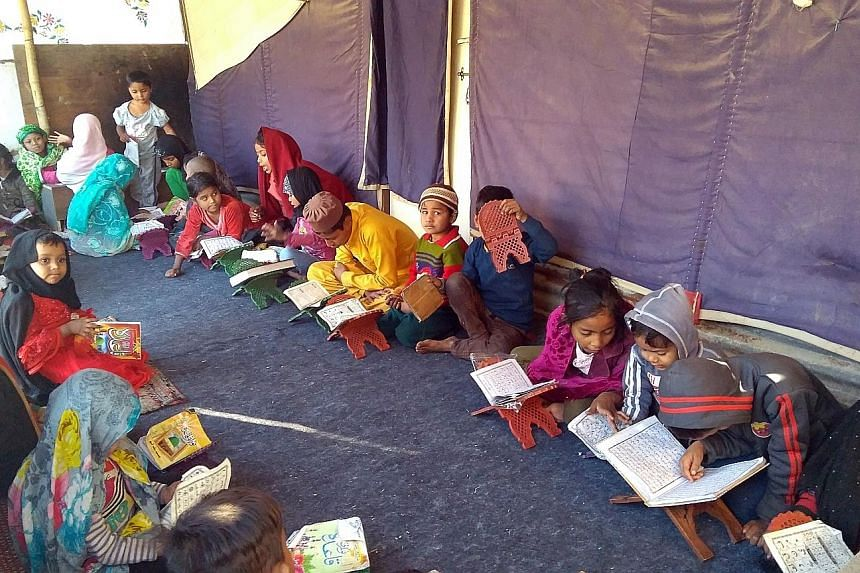 Children studying at a madrasah in the camp for Rohingya in New Delhi. All the 240 or so refugees in the camp are registered with the UNHCR but they still worry they may be the next to be sent back to Myanmar.