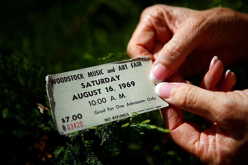 An original ticket at the site of the 1969 Woodstock Music Festival in Bethel, New York, where one 50th-anniversary event will take place.