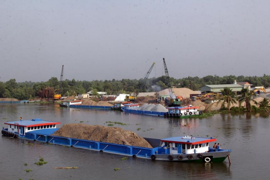 Upstream damming and extensive mining of the Mekong's riverbed for sand is causing the land between the sprawling network of rivers and channels near the mouth of one of the world's great rivers to sink.