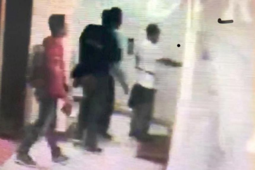 A screen grab from CCTV footage taken outside Mr Hartono Karjadi's Orchard Road apartment. It shows (from right) Mr Hartono, his friend, and two other men, who are believed to be police officers from Bali.