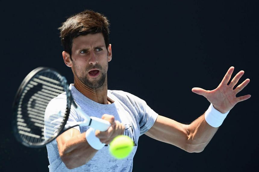 Novak Djokovic hits a return during a practice session ahead of the Australian Open tennis tournament in Melbourne, on Jan 13, 2019.
