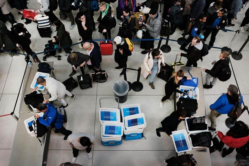 Passengers waiting in a Transportation Security Administration (TSA) line at JFK airport, on Jan 9, 2019, in New York City.