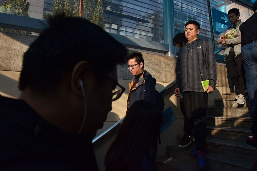 Commuters walking into a subway station in Beijing. A new one-day pass was announced by the municipal commission of transportation on Jan 13, 2019.