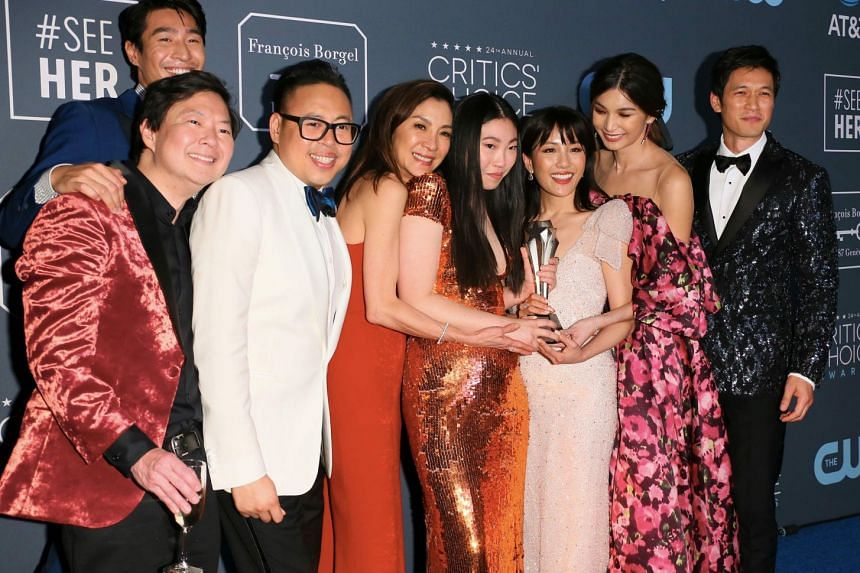 The cast of Crazy Rich Asians pose with the Best Comedy trophy during the 24th Critics' Choice Awards at Barker Hangar Santa Monica airport in Santa Monica, California, on Jan 13, 2019.