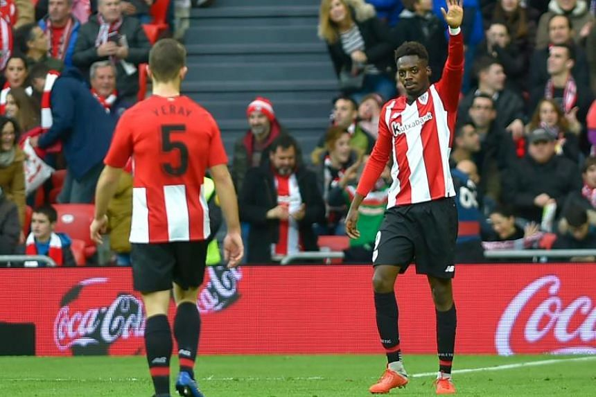 Athletic Bilbao's Spanish forward Inaki Williams (right) celebrates after scoring a goal during the Spanish League football match between Athletic Club Bilbao and Sevilla FC at the San Mames stadium in Bilbao on Jan 13, 2019.