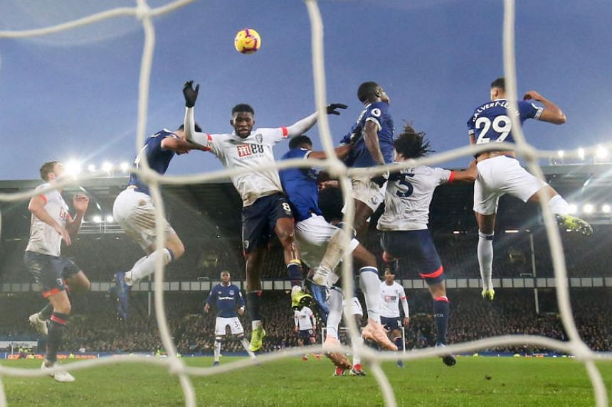 Bournemouth's Jefferson Lerma in action with Everton's Michael Keane and Kurt Zouma at Goodison Park, Liverpool, Britain, on Jan 13, 2019.