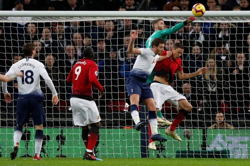 Manchester United's Spanish goalkeeper David de Gea punches the ball to make a save during the English Premier League football match between Tottenham Hotspur and Manchester United at Wembley Stadium in London, on Jan 13, 2019.