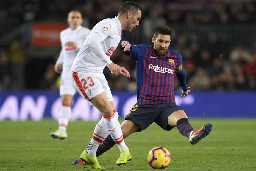 Eibar's Spanish defender Anaitz Arbilla (left) vies with Barcelona's Argentinian forward Lionel Messi during the Spanish League football match between FC Barcelona and SD Eibar at the Camp Nou stadium in Barcelona, on Jan 13, 2019.