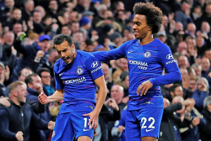 Spanish forward Pedro in good spirits after scoring Chelsea's opening goal against Newcastle, as Willian joins in the celebrations. The Brazilian netted the winner in the second half.