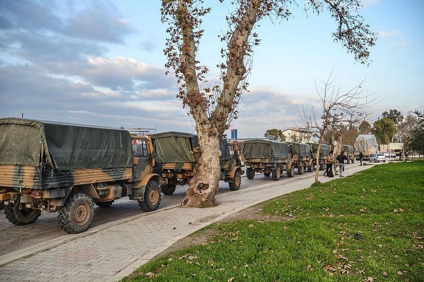 A Turkish military convoy in Kirikhan at the Syrian border last Saturday. Turkey has vowed to crush a US-backed Kurdish militia which it views as a terrorist group, but which has been a US ally in the fight against ISIS in Syria.