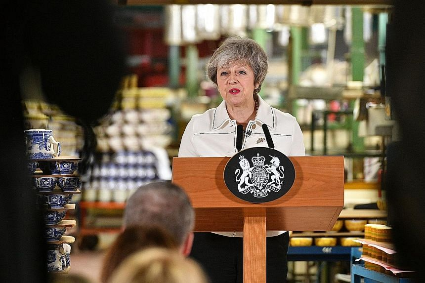 British Prime Minister Theresa May giving a speech at a factory in Stoke-on-Trent yesterday, during which she urged MPs to support her Brexit Bill in Parliament today.