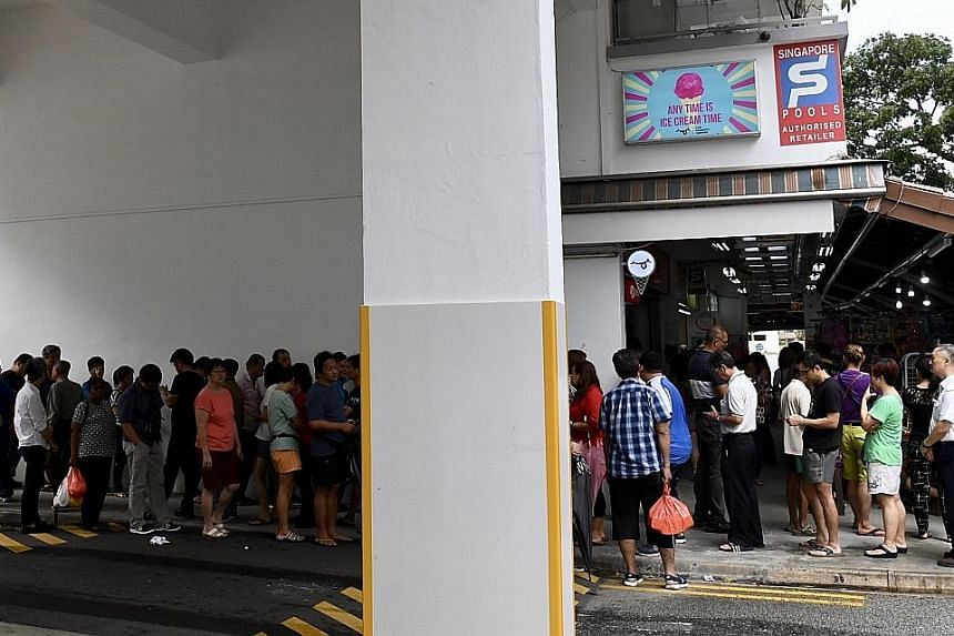 More than 200 punters queueing up to buy Toto tickets at Tong Aik Huat, a Singapore Pools authorised retailer, at Block 685, Hougang Street 61, yesterday. Last night, one person won the Group 1 cascade draw prize of $9,588,137. The winning ticket was