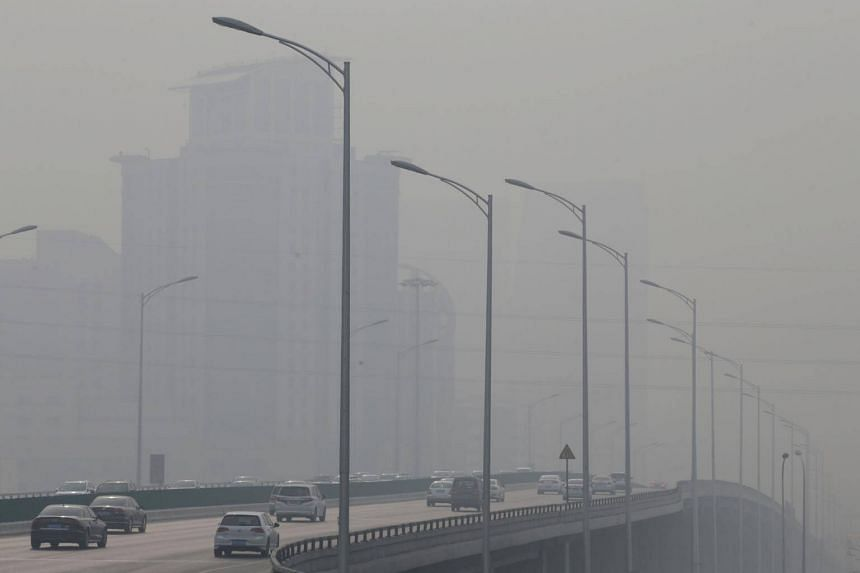 Vehicles move amid heavy smog on a polluted day in Beijing, China.