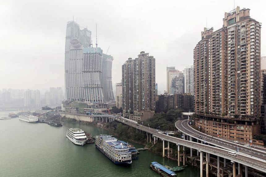 Boats docked near residential buildings along the Yangtze River in Chongqing, China, on Jan 4, 2019.