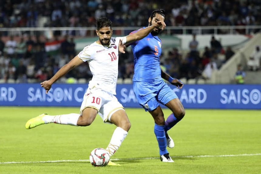 Bahrain's forward Abdulla Yusuf Helal (left) fights for the ball with India's defender Sandesh Jhingan during the AFC Asian Cup group A football match between India and Bahrain at the Sharjah Stadium in Sharjah on Jan14, 2019.