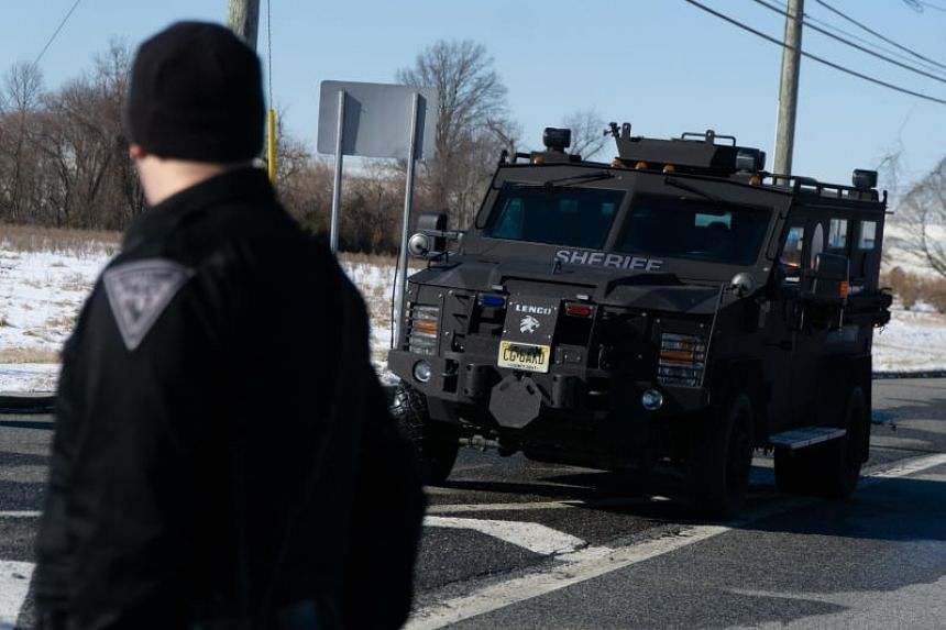 A Swat vehicle leaves the scene following a hostage situation at the United Parcel Service facility in Logan Township, New Jersey, US, on Jan 14, 2019.
