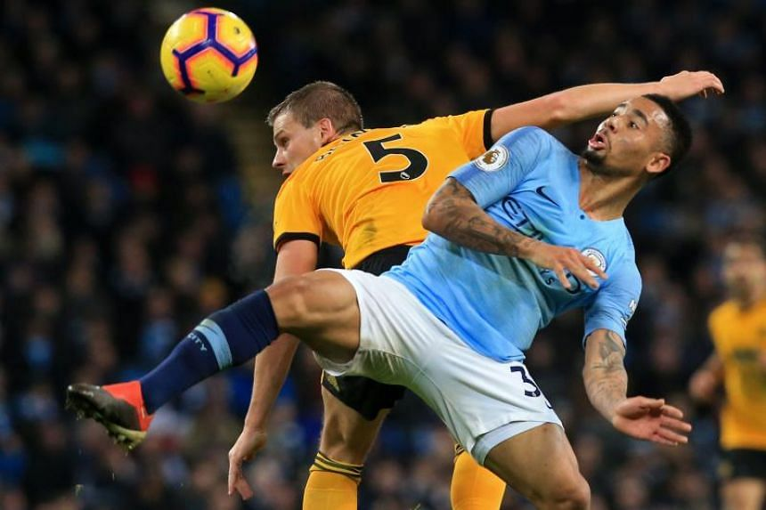 Wolverhampton Wanderers' English defender Ryan Bennett (left) vies with Manchester City's Brazilian striker Gabriel Jesus during the English Premier League football match at the Etihad Stadium in Manchester, north west England, on Jan 14, 2019.