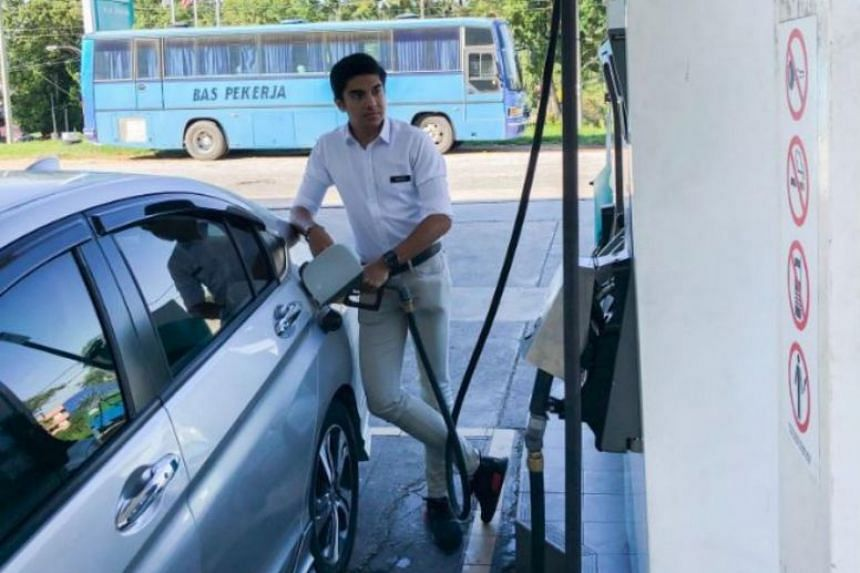 Malaysia's Youth and Sports Minister Syed Saddiq Syed Abdul Rahman fuelling up at a Petronas station on the way to Cameron Highlands.