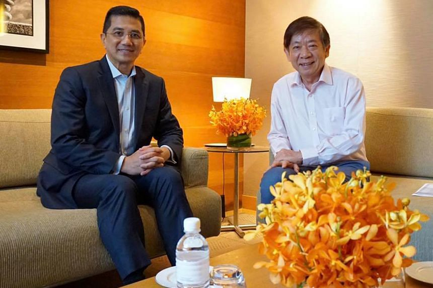 Mr Azmin Ali meeting Transport Minister Khaw Boon Wan yesterday.