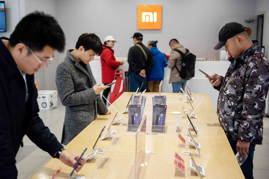 Customers at a Xiaomi shop in Beijing last November. Although Xiaomi started out as a smartphone brand, it is now recognised as a major technology brand with a big presence in consumer electronics, and is riding the wave of shoppers who buy local bra