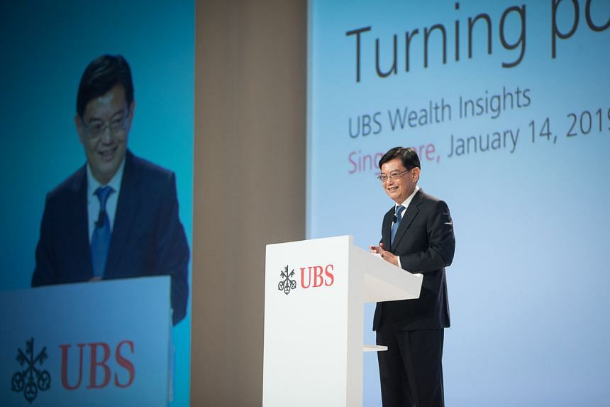 Finance Minister Heng Swee Keat launching the new Grant for Equity Market Singapore at a UBS conference yesterday. The grant supports the fund-raising needs of firms when they choose to list on the Singapore Exchange.