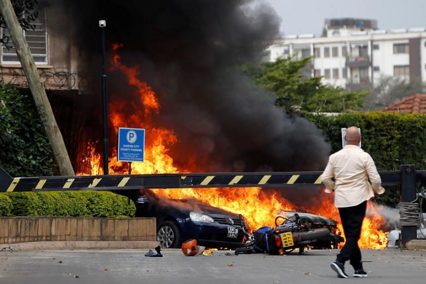 Vehicles on fire at the hotel compound at Riverside Drive.