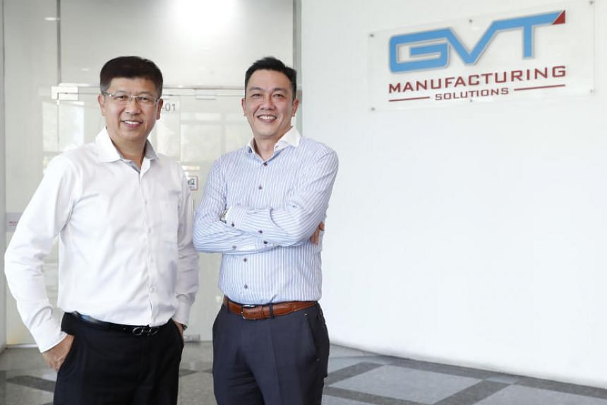 Chairman of Grand Venture Technology Ricky Lee (left) and chief executive Julian Ng.