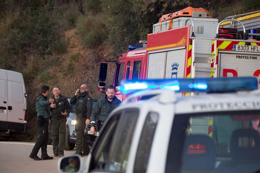 Spanish Civil Guard agents work near a well shaft into which a two-year-old boy fell.