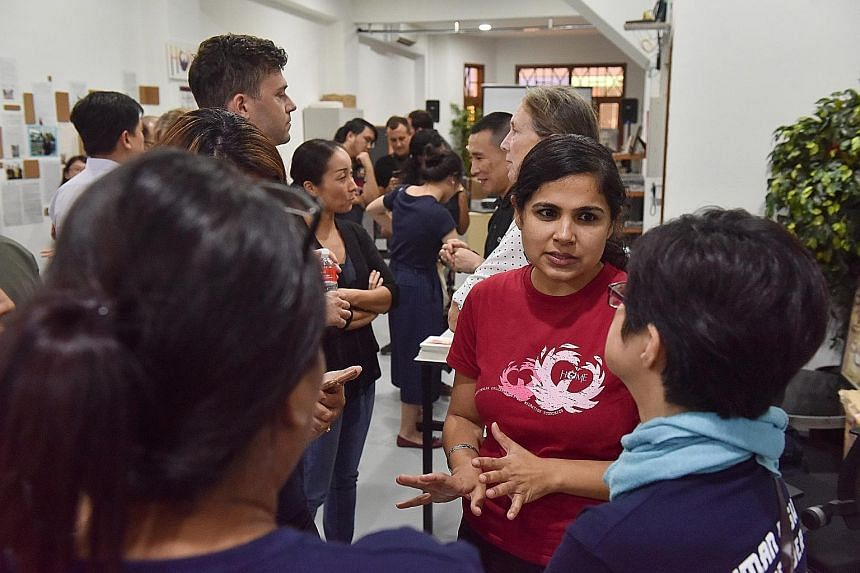 Ms Sheena Kanwar, Home's executive director, talking with participants at an event yesterday to launch the report by the group and Hong Kong-based anti-trafficking group Liberty Shared on forced labour in Singapore's domestic work sector.