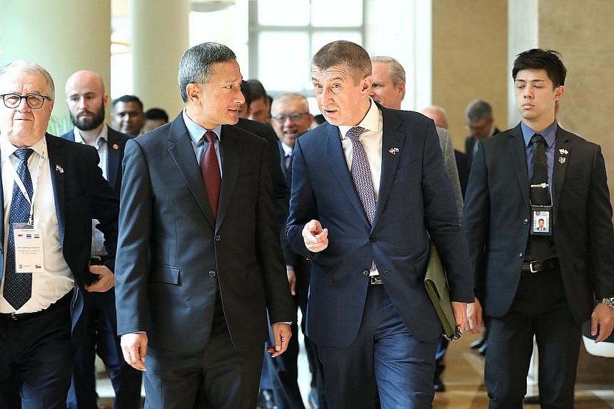 Left: Foreign Affairs Minister Vivian Balakrishnan and Czech Republic Prime Minister Andrej Babis arriving at The Ritz-Carlton, Millenia Singapore, for the fourth Singapore-Czech Republic Business Forum yesterday. Below: Mr Babis, flanked by Mr Chee