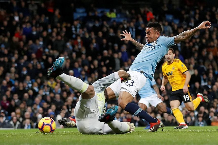 Manchester City's Gabriel Jesus stretches to tap in his first goal during their 3-0 win over Wolves. The Brazilian later added a second to take his prolific run this year to seven from three games as the champions cut Liverpool's lead atop the Premie