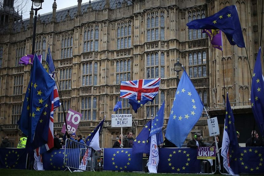 Pro-Brexit and anti-Brexit demonstrators outside the Houses of Parliament yesterday ahead of a parliamentary vote on the Brexit deal struck between British Prime Minister Theresa May's government and the EU. A comparatively narrow defeat could allow
