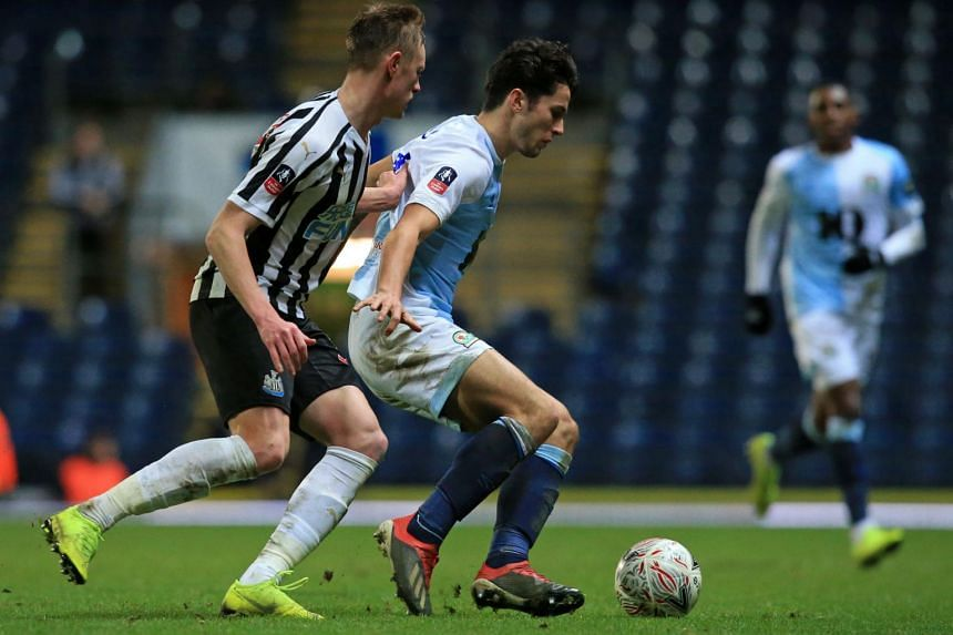 Newcastle United's English midfielder Sean Longstaff (left) vies with Blackburn Rovers' English midfielder Lewis Travis during the English FA Cup third round replay football match at Ewood Park in Blackburn, north west England on Jan 15, 2019.