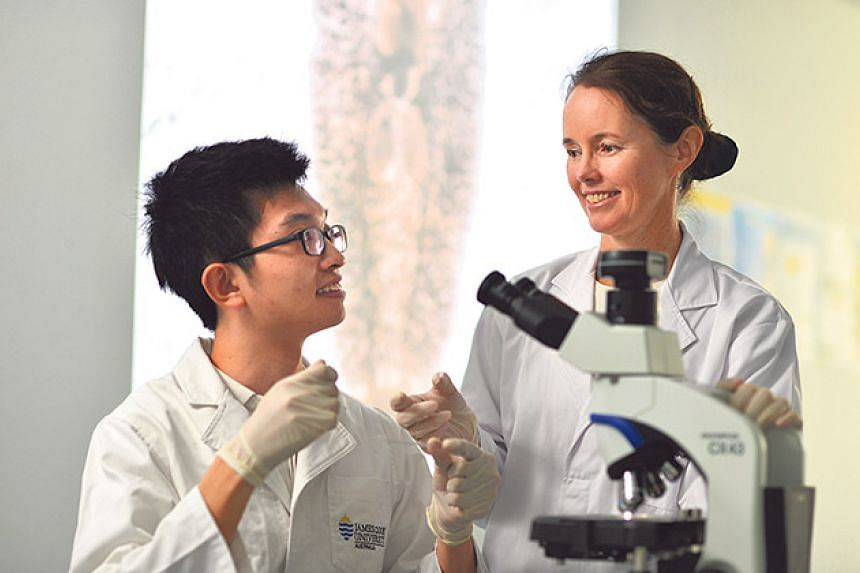 James Cook University's aquaculture department boasts experts from all over the world, such as Prof Cobcroft (right). PHOTO: CHONG JUN LIANG