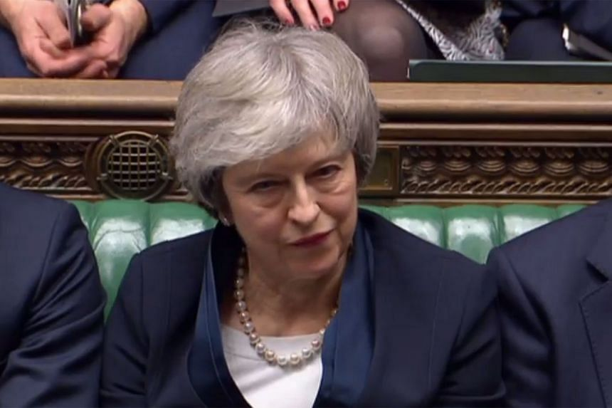Theresa May reacts as Labour Party leader Jeremy Corbyn makes his comments and informs MPs that he has tabled a vote of no confidence in the Government.
