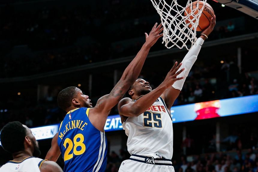 Denver Nuggets guard Malik Beasley (right) drives to the net as Golden State Warriors forward Alfonzo McKinnie defends in the second quarter at the Pepsi Center, in Denver, US, on Jan 15, 2019.