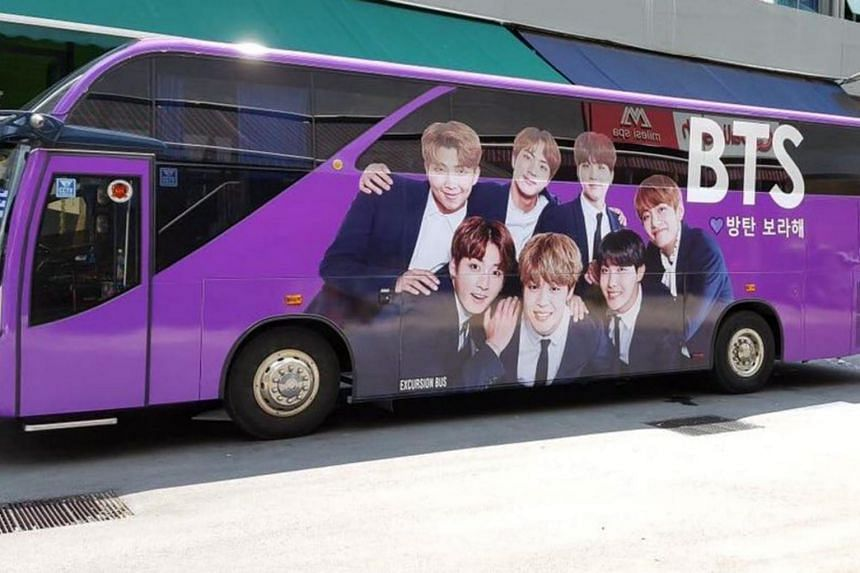 A purple bus adorned with the faces of K-pop juggernaut boyband BTS - paid for by some 27 fans here to promote BTS in the lead-up to their concert in Singapore on Saturday (Jan 19).