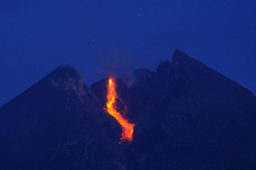 Incandescent lava has been spewing from Mount Merapi's crater, and the volcano has been emitting booming sounds resembling thunder more frequently.