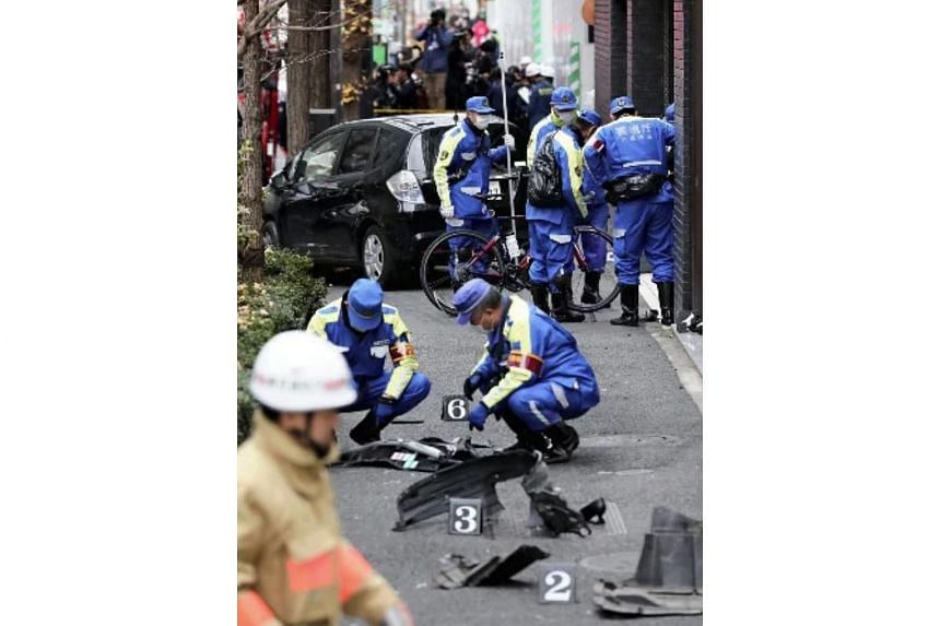 Police investigators collecting evidence at the site of an accident in Tokyo, where an elderly driver mounted the kerb and hit several pedestrians, on Jan 16, 2019.