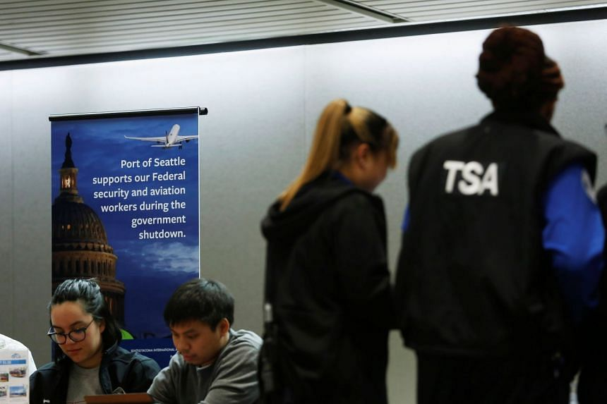 TSA agents attend a resource fair for employees affected by the partial federal government shutdown at Seattle-Tacoma International Airport in Seattle, on Jan 14, 2019.