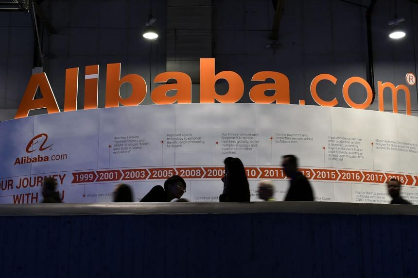 People passing by an Alibaba.com display at the Las Vegas Convention Center, on Jan 8, 2019 in Las Vegas, Nevada.