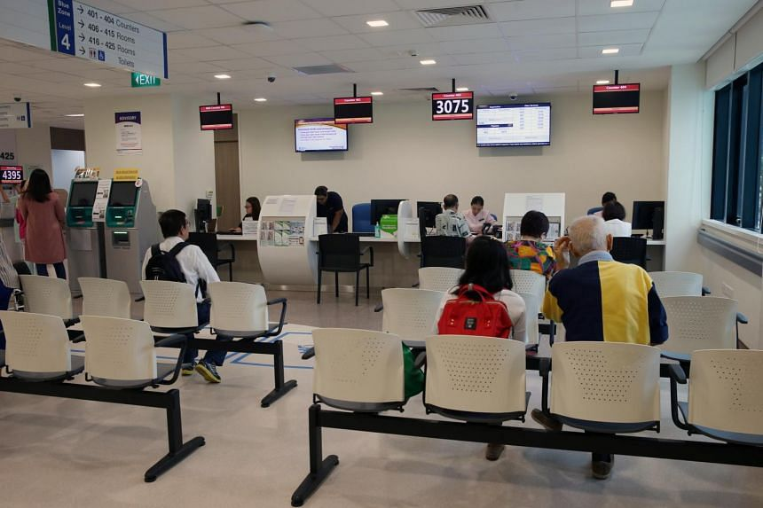 People at a waiting area at a medical centre in Singapore General Hospital, on Feb 20, 2017.