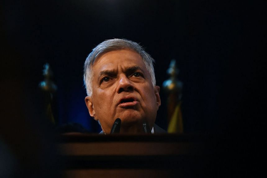 Ranil Wickremesinghe speaks to supporters at the prime minister's official residence in Colombo in December 2018.