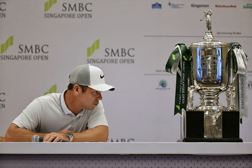 Paul Casey looking at the trophy ahead of the SMBC Singapore Open in Sentosa yesterday.
