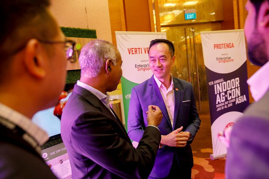 Dr Koh Poh Koon, Senior Minister of State for Trade and Industry, with Mr Veera Sekaran, one of the directors of VertiVegies, an indoor vertical farming firm, at the Indoor Ag-Con Asia conference at Marina Bay Sands Expo and Convention Centre yesterd