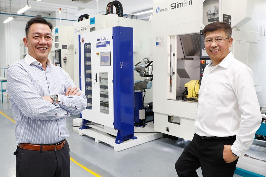 Grand Venture Technology chief executive Julian Ng (left) and executive chairman Ricky Lee. Mr Ng says some of the IPO proceeds will go towards transforming the company with automation